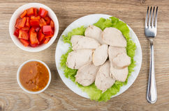 Chicken meat with lettuce in plate, sweet pepper, sauce Stock Photos