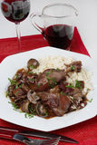Chicken meat with mushrooms in red vine sauce. And boiled rice Royalty Free Stock Photography