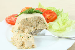 Chicken meat pate and salad. A moulded pate of chicken meat, cream cheese, gelatin and herbs served with a lettuce and tomato salad Royalty Free Stock Photography