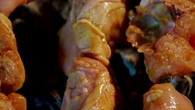 Chicken meat pieces being fried on charcoal grill stock video footage