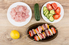 Chicken meat in plate, vegetables, raw shashlik in dish Royalty Free Stock Image