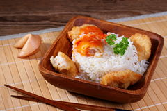 Chicken meat with rice, red sauce on bamboo mat Stock Photography