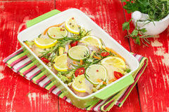 Chicken meat with rosemary and lemon Stock Photography