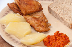 Chicken meat served with ajvar and potato Royalty Free Stock Photos