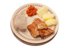 Chicken meat served with ajvar and potato Royalty Free Stock Image