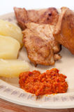 Chicken meat served with ajvar and potato Stock Photo