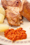 Chicken meat served with ajvar and potato Stock Images