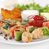 Chicken meat skewers meal with potatoes and vegetables on plate Stock Photography