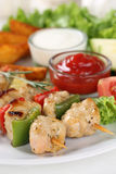 Chicken meat skewers meal with sauce Royalty Free Stock Photo