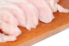 Chicken meat sliced   on  cutting  board Royalty Free Stock Photos