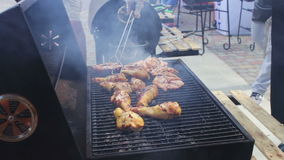 Chicken meat that turn over on a barbecue grill.Meat is fried in Mangal Barbecue grill. Chicken meat on the grill during. A picnic stock video footage
