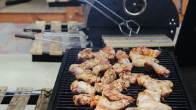 Chicken meat that turn over on a barbecue grill.Meat is fried in Mangal Barbecue grill. Chicken meat on the grill during stock footage