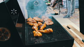 Chicken meat that turn over on a barbecue grill.Meat is fried in Mangal Barbecue grill. Chicken meat on the grill during. A picnic stock video