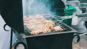 Chicken meat that turn over on a barbecue grill.Meat is fried in Mangal Barbecue grill. Chicken meat on the grill during. Chicken meat on a barbecue grill.Meat stock video footage