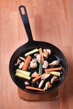 Chicken meat and vegetables on a pan Stock Photos