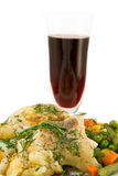 Chicken meat with vegetables and red wine glass Royalty Free Stock Photos