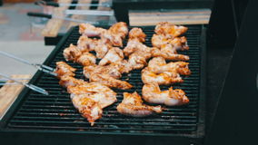 Chicken meat wings that turn over on a barbecue grill.Meat is fried in Mangal Barbecue grill. Chicken meat on the grill. During a picnic stock video footage