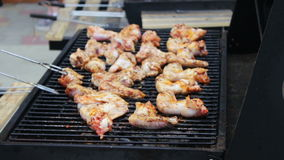 Chicken meat wings that turn over on a barbecue grill.Meat is fried in Mangal Barbecue grill. Chicken meat on the grill stock footage
