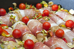 Chicken meat wrapped in bacon royalty free stock photography