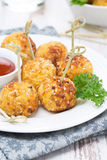 Chicken meatballs in breading with tomato sauce, closeup Stock Photo