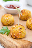 Chicken meatballs in corn breading with tomato sauce Stock Photography