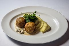 Chicken meatballs with mushroom sauce royalty free stock photo