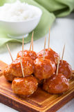 Chicken meatballs on skewers. Served with rice, easy appetizer Royalty Free Stock Images