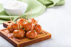 Chicken meatballs on skewers. Served with rice, easy appetizer Stock Images