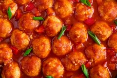 Chicken meatballs in spicy tomato sauce with vegetables. Mexican cuisine. Top view. Chicken meatballs in spicy tomato sauce with vegetables. Mexican cuisine stock photography
