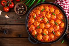Chicken meatballs in spicy tomato sauce with vegetables in pan. Mexican cuisine. Top view royalty free stock photography