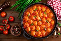 Chicken meatballs in spicy tomato sauce with vegetables in pan. Mexican cuisine. Top view royalty free stock photos