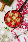 Chicken meatballs with tomato sauce in a frying pan. style vintage Royalty Free Stock Images