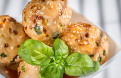 Chicken meatballs under sweet chili pepper sauce Stock Images