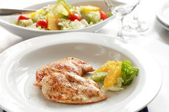Chicken medallions with salad Stock Photography