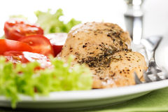 Chicken meet on plate macro. Chicken meet with tomatoes in plate Stock Photos