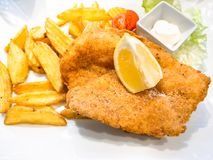 Chicken Milanese schnitzel with fried potatoes royalty free stock images