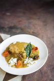 Chicken mild yellow curry modern fusion asian food Stock Image