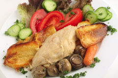 Chicken and mushroom casserole with salad Stock Images