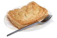 Chicken & Mushroom Pastry Slice. On a paper plate with a plastic fork Royalty Free Stock Photos