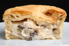Chicken & Mushroom Pie. Individual chicken & mushroom pie sliced open Stock Photos