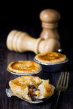 Chicken and Mushroom Pie. With pepper and salt dispenser as background stock photography