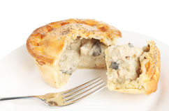 Chicken and mushroom pie on a plate Royalty Free Stock Photo