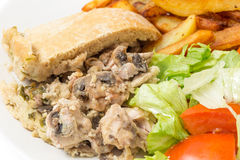 Chicken and mushroom pudding closeup Stock Images