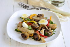 Chicken and mushroom salad with quail eggs and fresh herbs Stock Images