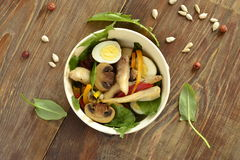 Chicken and mushroom salad with quail eggs and fresh herbs Stock Photo