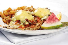 Chicken mushroom and tomato eggs benedict Stock Images
