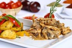Chicken and mushroom with tomato sauce and potato, salad stock image