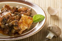 Chicken and mushrooms Stock Photography
