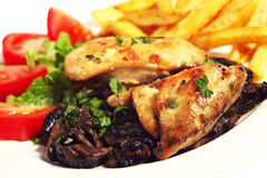 Chicken and mushrooms with chips Stock Photos