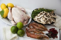 Chicken, mushrooms and dressings on a tablecloth. On clear background royalty free stock photos